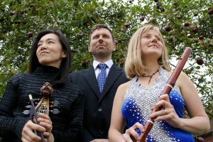 Passacaglia trio beneath tree