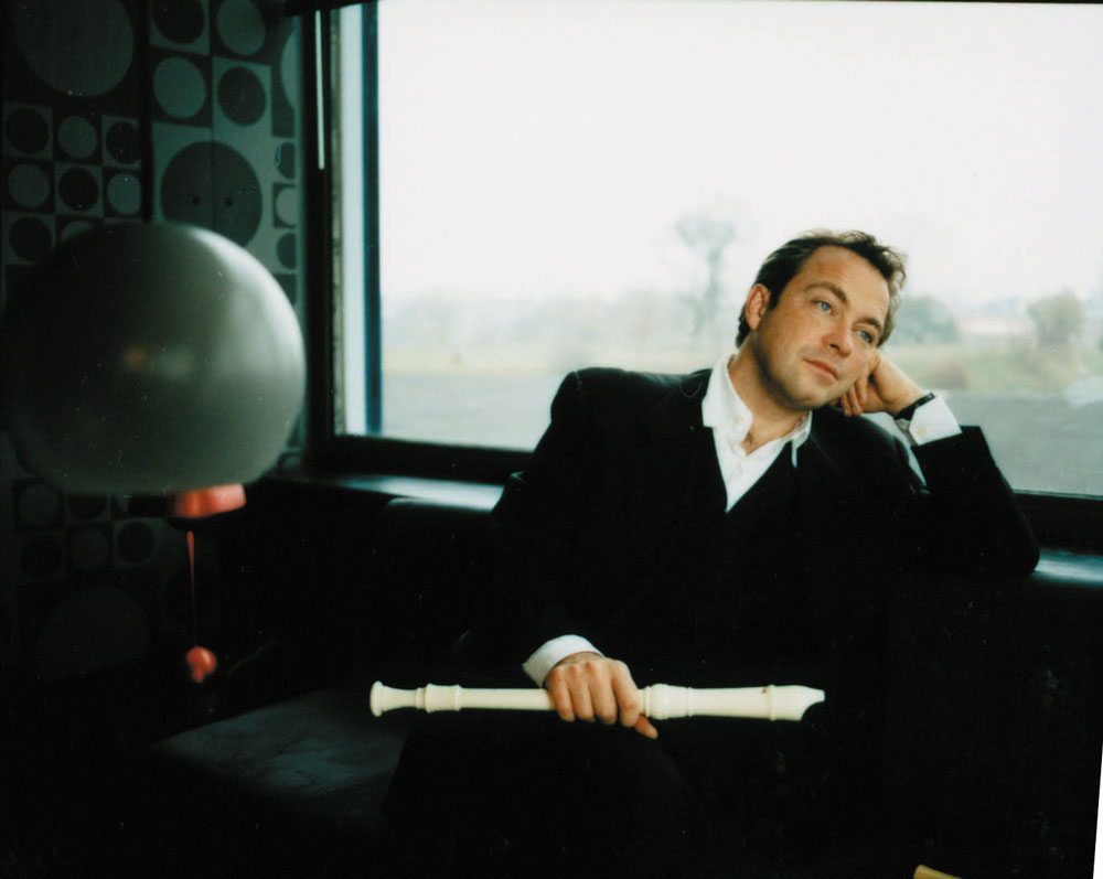 Dan Laurin sitting, with white recorder