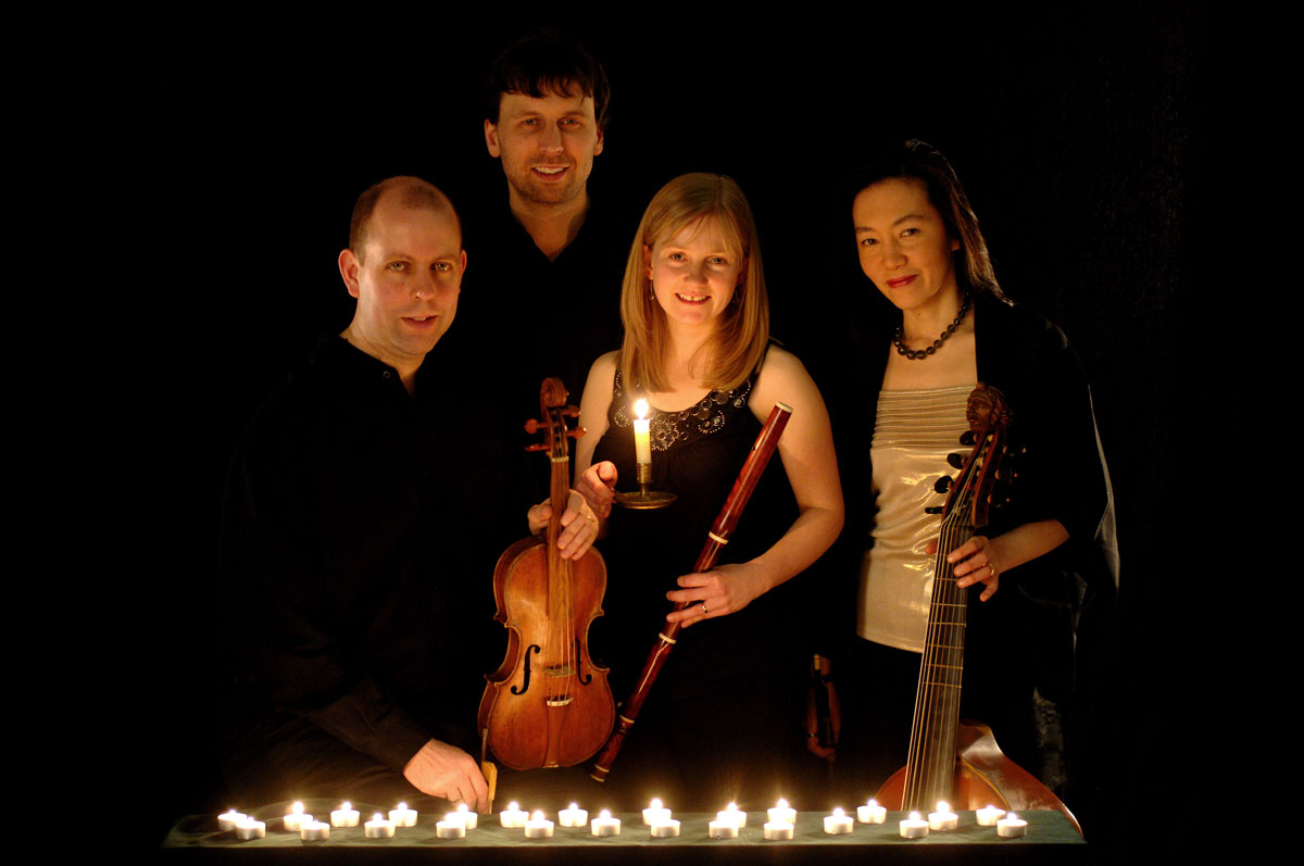 Passacaglia lit by candles, with instruments