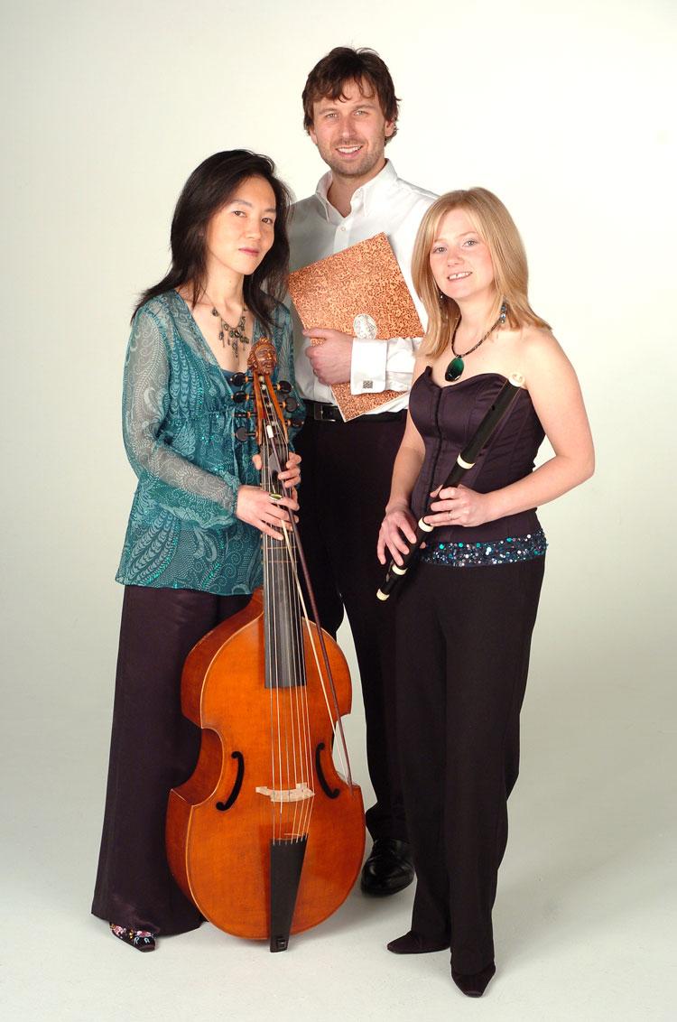 Passacaglia trio in white studio with instruments